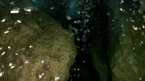 A scuba diver explores underwater caves in Florida Stock Video Footage