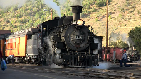 A steam train leaving the station Stock Video Footage