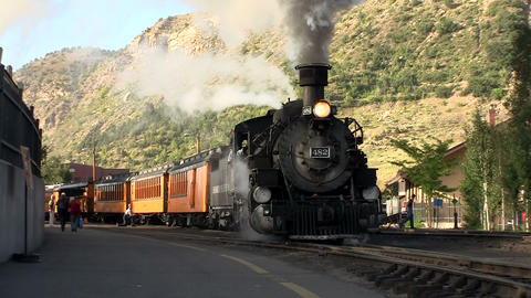 A steam train leaving the station Footage