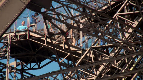 Tourists walk on the Eiffel Tower in paris Stock Video Footage
