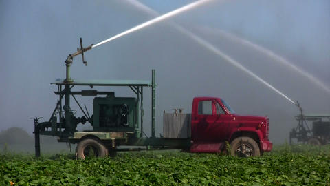 Irrigation trucks water fields Stock Video Footage