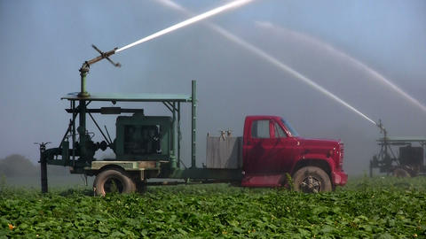 Irrigation trucks water fields Footage