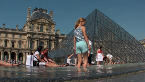 Children play in front of the Louvre in Paris Footage
