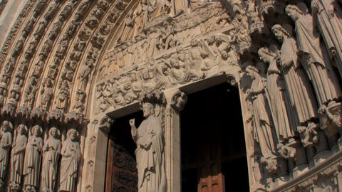 Handheld tilt up facade of Notre Dame Cathedral, P Stock Video Footage