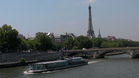 The Seine and the Eiffel Tower with riverboats in  Footage