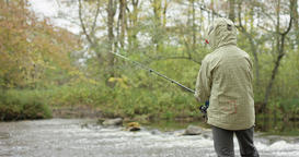 Boy fishing in autumn, RED footage Footage