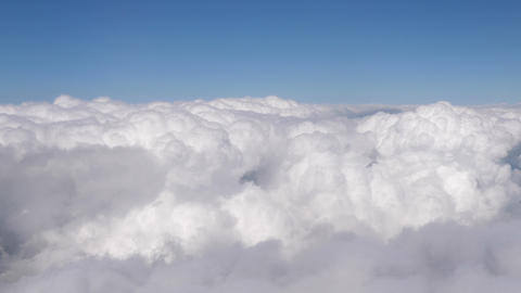 Flight in the clouds in 4K Live Action