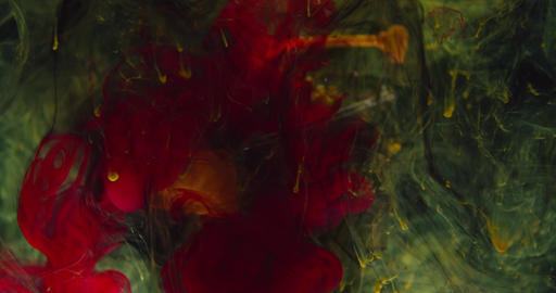 Underwater footage of the red and yellow ink floating in clouds underwater, 4k Live Action