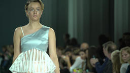 The girl shows the dress during fashion show Footage