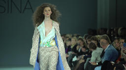 Female models show clothes during the fashion show Footage