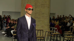 Guy model shows stylish clothes . Slow motion Footage