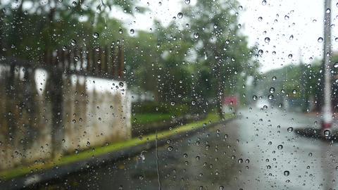 Rain drops on windows Focus on rain drops down the window in rainy day Live Action