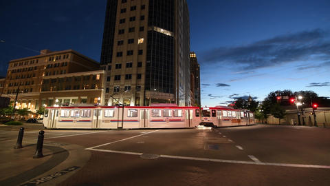 SALT LAKE CITY - JULY 14, 2019: City tram speeds up along Downtown Streets on a Live Action