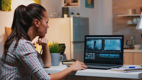 Videographer editing from home on professional laptop Live Action