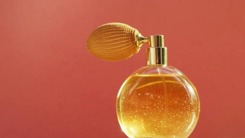 Golden perfume bottle and shining light flares, chic fragrance scent as luxury Live Action