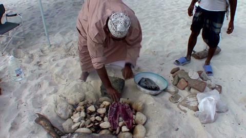 fish barbecue on the rocks Omani way Footage