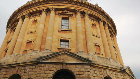 Panning shot revealing the large complex of college buildings in Oxford, UK Footage