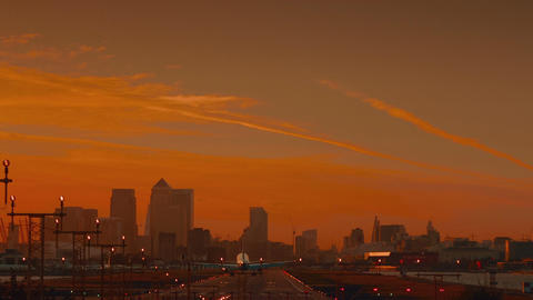London City Airport - Wide angle view of a large airplane landing during sunset Footage