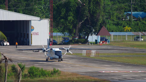 Royal Thai Navy small transport aircaft taxiing from hangar Live Action