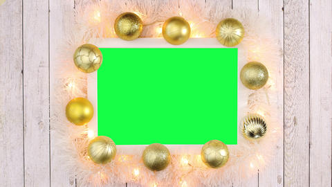 Gold Christmas frame with gold balls, blinking lights and green screen. Stop motion Live Action