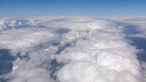 Flight above the clouds in 4k Live Action