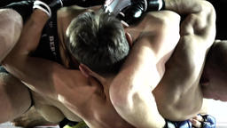 Fighters in the cage . MMA. Slow motion Footage