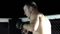MMA. Slow motion. Fight in the cage Footage