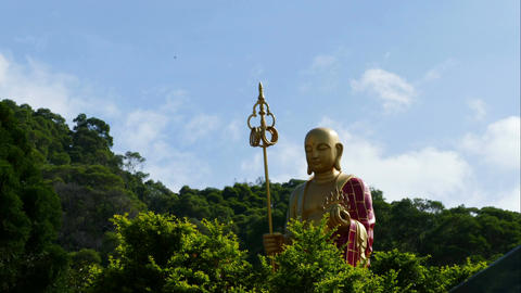Buddha statue with clouds in time lapse Footage