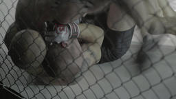 Hard fight between two fighters in the cage. MMA Footage