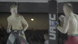 Fighters fight in a cage. Oktagon. MMA Footage