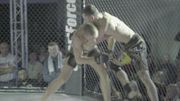 The fight in the octagon in action . MMA Footage