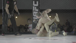Fighter beats another fighter in the cage . MMA Footage