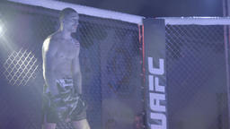 Fighter before the fight in the octagon . MMA Footage