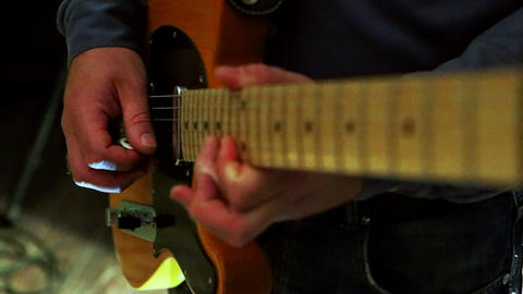 Closeup Guy Plays Guitar at Rehearsal in Studio Footage