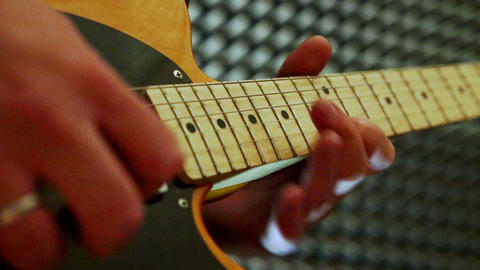 Closeup Guy Plays Guitar Touches Neck in Studio Footage