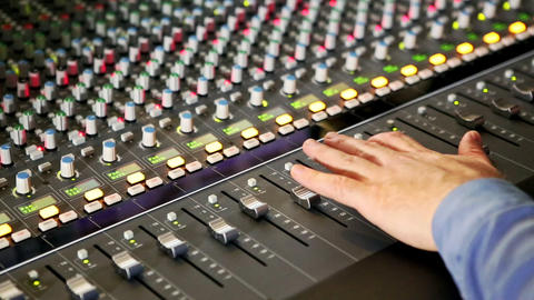 Closeup Musical Mixing Console Guy Hand Pushes Faders Live Action