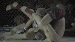 Hard fighters fighting each other . MMA Footage