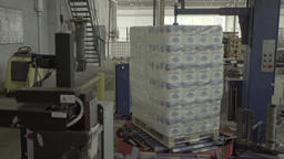 The product is wrapped with film on the conveyor belt during production Live Action