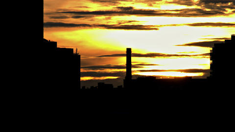 4K Sun Sets on Background of Contrasting Shapes of Urban Buildings And Footage