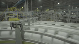 A conveyor belt while working at the paper factory Live Action