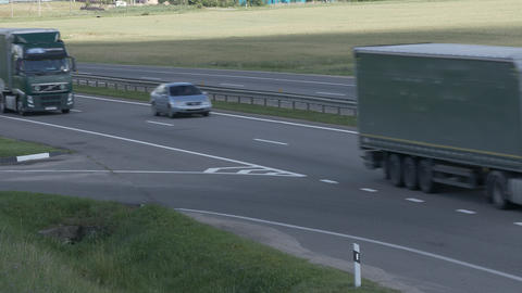 4K Ungraded: Two Trucks Drive on Intercity Highways Footage