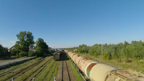 Fast flight along freight carriages Live Action