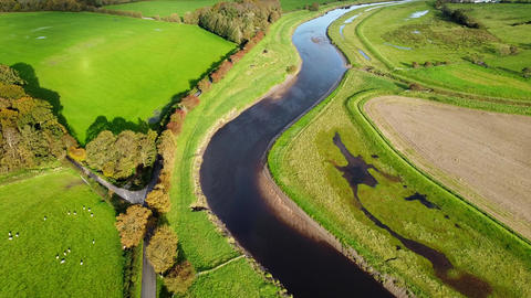 Aerial Overhead Drone Shot flying over River in UK Countryside (4K) Live Action