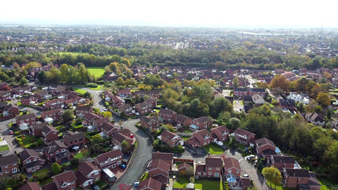Aerial Overhead Drone Shot over Town in UK, Houses and Trees (4K) Live Action