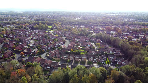 Aerial Overhead Drone Shot over UK Town Houses and Trees (4K) Live Action