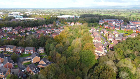 Aerial Overhead Drone Shot Slight Pan as Sunlight Crosses Houses and Trees (4K) Live Action