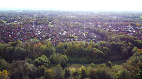 Aerial Drone Shot Flying over Trees towards Houses in Neighbourhood Estate Mist in Distance (4K) Live Action