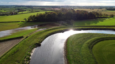 Overhead Aerial Drone Shot Over Corner of River in UK Countryside (4K UHD) Live Action