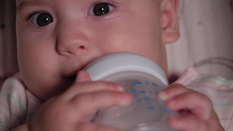 infant, childhood, emotion concept - Extreme close-up of smiling face of brown Live Action