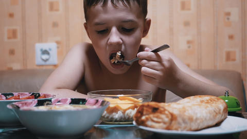 Hungry Child Eats Pasta with a Fork. Homemade Food. Concept of Fast Food at Home Animation